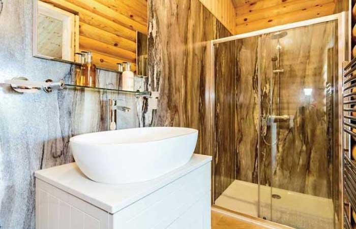 Kuivasalmi, maison rondin bois, salle de bain